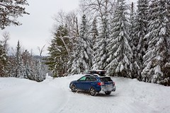 A blue station wagon car parked on a snow-covered forest trail in the woodlands of northern Minnesota, United States (thstrand) Tags: alone american auto automobile autos bwca bwcaw bluecar boundarywaterscanoearea car cars cloudy cold conditions conifer conifers forest forests holidaytravel landscape landscapes lone mn minnesota mortorvehicle nobody northamerica northernminnesota onecar outback outdoor outdoors overcast pinetrees pines plants recreation road roads ruralscene scenery scenicviews season seasons snow snowcovered subaru superiornationalforest theroadahead tourism touristdestinations trail trails transport transportation traveldestination traveldestinations trees us usa unitedstates vacation weather weatherconditions white wilderness winter woodland woodlands woods