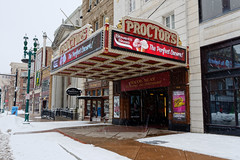 Snowing in Schenectady (fotofish64) Tags: schenectady city downtown downtownschenectady businessdistrict mainstreet theater proctorstheatre marquee sign bulbsign proctorsarcade sidewalk schenectadycounty newyork capitaldistrict snow winter snowfall color red outdoor weather streetlight pentax pentaxart kmount k70 hdpentaxda1685mmlens streetscape urban