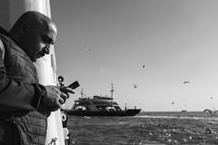 Stick & Moustache (Ktoine) Tags: commute bold street boat ferry turkey istanbul people sea bosphore bosphorus telephone phone