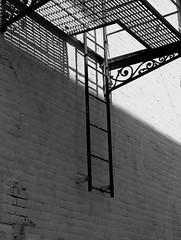 Escape (jHc__johart) Tags: bw fireescape ladder ornamental wall kansas