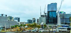 Melbourne Docklands redevelopment (Peter.Stokes) Tags: australian city colour colourphotography landscape photography transport wildlife outdoors photo australia cityscape buildings docklands cranes glass architecture in explore