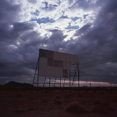 up on the big screen. parker, az. 2018. (eyetwist) Tags: eyetwistkevinballuff eyetwist clouds desert abandoned drivein movie theater screen parker arizona mamiya 6mf 50mm fuji velvia 100 transparency chrome mamiya6mf mamiya50mmf4l fujivelvia100rvp rvp fujichrome ishootfilm ishootfuji analog analogue film emulsion square 6x6 mediumformat 120 filmexif iconla epsonv750pro lenstagger mojave mojavedesert lonely flat landscape barren peeling derelict ruin forgotten roadsideamerica americantypologies violet saturated cinema doublefeature tumbleweeds coloradoriver americana gloom