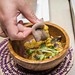 Eating with injera at Selam Vegan Restaurant, Toronto