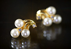 Queen of Gems (Through Serena's Lens) Tags: macromondays jewelry pearlearrings diamonds gold macro reflection shining darkbackground bokeh dof tabletop canoneos6dmarkii stilllife
