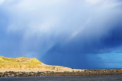 Heavy rain shower. (artanglerPD) Tags: ythan estuary seals sun sand heavy clouds