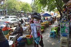 In the Tudu market (Francisco Anzola) Tags: ghana accra africa city market woman people trees cars