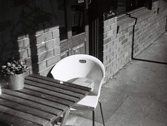 Chair at Olinda Pizza (Matthew Paul Argall) Tags: ansco50 fixedfocus 110 110film subminiaturefilm lomographyfilm 100isofilm blackandwhite blackandwhitefilm grainyfilm plasticlens haking