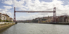 Cross view of the bridge (fnks) Tags: spain bilbao portugalete getxo river banks sanctuary water ships ocean bay houses bridge float steelconstruction clouds sky cranes gondola nervionriver holidays pedestrianwalkway basquecountry bayofbiskay construction mechanicalengineering cables dunes
