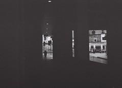 Frames, Inverness, April 2016 (Mano Green) Tags: shadow light silhouette dark black white inverness scotland city street uk spring april 2016 lomo smena symbol ilford xp2 super 400 35mm film person