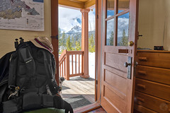 Ready to Space Walk (Musgrove and the Pumi) Tags: redfishcabin redfishguardstation redfishlake northernshore sawtoothnationalforest idaho id sawtoothnationalrecreationarea woodenstructure civilianconservationcorps historic publicland usdaforestservice forestservicerentalprogram rusticcabin doorway threshold remotecabin cabininthewoods pacificnorthwest recreationalrental forestroad214 snow trees forest landscape clouds sky woods mountains keltyredwing50backpack