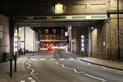 Night Shoot, 89 (doojohn701) Tags: bridge streetlighting street girders glare crossing brickwork buildings night dusk dark junction car red lights road lines shadow uk