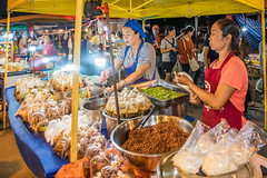 Vendors at the night market (HellonEarth2006) Tags: burma takprovince thailand asian border eating ethnic food forsale maesot man myanmar nightmarket north northern selling southeastasia vendors woman