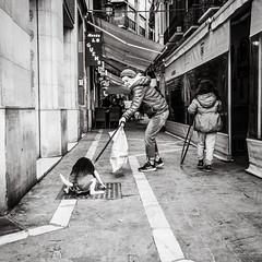 walking the dog (Gerard Koopen) Tags: malaga spain espana straat street straatfotografie streetphotography city dog walkingthedog candid streetlife blackandwhiteonly blackandwhite noir people woman women beautiful beauty urban sony sonyalpha a7iii 35mm 2019 gerardkoopen gerardkoopenphotography