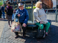 Leeds 044 (Peter.Bartlett) Tags: bag sitting unitedkingdom bench people city urbanarte westyorkshire colour lunaphoto man girl candid uk couple woman urban hat streetphotography ricohgr peterbartlett leeds england gb