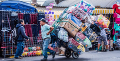 2018 - Mexico -  Mexico City - Overload - 1 of 2 (Ted's photos - Returns Saturday) Tags: 2018 cropped mexico mexicocity nikon nikond750 nikonfx tedmcgrath tedsphotos tedsphotosmexico vignetting streetscene street people peopleandpaths pathsandpeople worker denim denimjeans ballcap backpack handtruck cart ropes male man cdmx