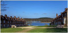 Bucklers Hard (clive_metcalfe) Tags: bucklershard beaulieu hampshire uk river boats buildings grass seat bench yacht pub hotel forest newforest water blue clouds winter sunny