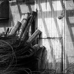 All that Remains (Sheila Newenham) Tags: 500px barn doors nikon19 wisconsin barbedwire rustic wood