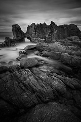 Kissing Rock, Monterey (Chris Skopec) Tags: california coast landscape lucaspoint monterey pacificgrove pacificocean thekissingrocks usa coastal landscapephotography longexposure rocks scenic travel waves blackwhite