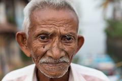 Street Portrait, Fort Kochi (Geraint Rowland Photography) Tags: face head headshot portrait streetportrait fortkochi kerala india indianman elderly content wise wisdom geraintrowlandphotography wwwgeraintrowlandcouk eyes sad despair hair travelportraits