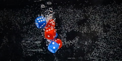 Sinking dice (benjamin.t.kemp) Tags: colours colorsinourworld die dice stockphoto water bubbles shadow dark red blue background object bokehlicious