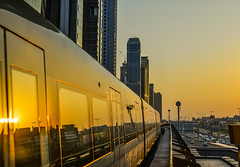 A metro train running on track at sunset (phuong.sg@gmail.com) Tags: arab arabia architecture building center city cityscape design development downtown dubai east editorial emirates futuristic futuristiccity industry landmark landscape metro middle modern motion new rail railroad railway road skyline skyscrapers station street subway sunset terminal tourism tower traffic train transport travel uae united urban