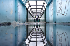 The running man (Paul Wrights Reserved) Tags: leadinglines leading reflection reflections reflectionphotography graffiti tunnel bridge litter rubbish urban pentax k1 light action selfie composition