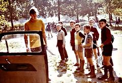 'Hello, campers!' (Peter Denton) Tags: visp switzerland europe europa martinmaclean 1965 campingholiday cardoor playground schoolboys children boys ©peterdenton viège candid street scan 35mm film analogue