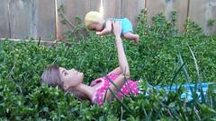 Bonding (Tee-Ah-Nah) Tags: baby doll barbie grass outside