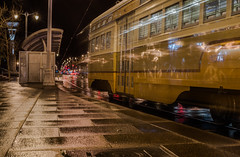 streetcar 1075 (pbo31) Tags: batarea california nikon d810 color march 2019 boury pbo31 winter sanfrancisco city night dark black lightstream traffic motion roadway infinity embarcadeo reflection rain wet weather streetcar muni blur yellow