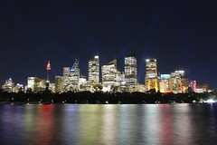Australia - New South Wales - Sydney - Colours (simon.j.prs) Tags: sydney australia city skyline illuminated colorful light beams winter reflection wales south new downtown district financial park towers stars sky backpacking exposure long