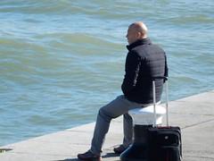 Seemed a Bit Godot Like ..... (mikecogh) Tags: vienna riverdanube donau waiting mystery suitcase bollard swell waves