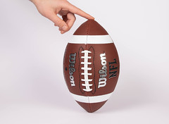 Hand holding a football ready for kicking (wuestenigel) Tags: 2025 superbowl 2022 american 2023 match ball football nfl competiton 2026 2019 2020 final 2021 2024 sport grass kick game hands brown woman frau achievement leistung one ein noperson keineperson isolated isoliert conceptual konzeptionell easter ostern people menschen health gesundheit desktop food lebensmittel fun spas maternity mutterschaft chocolate schokolade love liebe indoors drinnen text