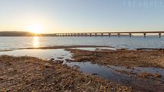(Freagull) Tags: sunset bridge beach riverbank sunsetbeach rockybeach river