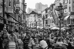 Hot town, summer in the city (Alexander Dülks) Tags: pedestrianzone lantern monochrom street café markt menschen streetlamp innenstadt sw citycentre sternstrase fusgängerzone laterne people monochrome 1992 analog bw bonn