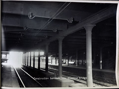 Overhead construction beneath low overline bridge. (Public Record Office Victoria) Tags: railways train electrification blackandwhite archives victoria construction bridge 1919