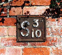 S (amazingstoker) Tags: stop cock stopcock sign 10 cast iron brick wall rust mortar 3 inch feet