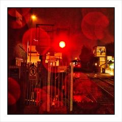 Rainy Days and Mondays (david.hayes77) Tags: bamberbridge lancs lancashire tsbg bamberbridgestationlevelcrossingframe night rain class142 142050 noddingdonkey 2n12 red stationroad arty raindrops abstract