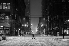 Winter night in downtown Toronto (HisPhotographs.com) Tags: snow toronto winter man yonge street cold urban streetphotography night nightlife nightshooter lamps store stores shop shops downtown city center light lights lowlight stride maninstride lonely jacket boots