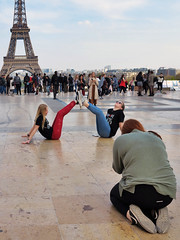 Making the frame to the Eiffel Tower with the legs of two girlfriends (pivapao's citylife flavors) Tags: paris france trocadero girl photographer architecture children