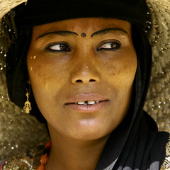 Portrait Of A Woman With Painted Eyebrows And Wearing A Straw Hat, Jebel Saber, Taiz, Yemen (Eric Lafforgue) Tags: adult arabia arabiafelix arabianpeninsula browneye colourpicture contemplation darkskin day djebelsaber earrings eye eyebrowtattooing eyelines flowershape jebelsaber looking lookingatcamera makeup oneperson onewoman peace placeofinterest portrait realpeople santal square strawhat taizz taez taiz tribal woman yemen img5120