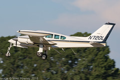 N720L - 1968 build Cessna 320F Executive Skyknight, climbing on departure from Runway 36L at Oshkosh during Airventure 2018 (egcc) Tags: 320f 320f0042 airventure airventure2018 ce320 cessna cessna320 eaa executiveskyknight kosh lemmen lightroom n320bc n720l osh oshkosh skyknight