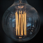 Close-up shot of glowing filaments in an incandescent light bulb thumbnail