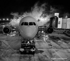 De-Icing (mswan777) Tags: tarmac jetway gate black white light monochrome mobile iphone iphoneography apple illinois chicago cockpit terminal concourse ice weather storm night airport airplane travel