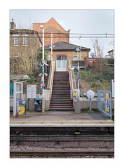 The Built Environment, North London, England. (Joseph O'Malley64) Tags: station frustration travel traveller dayout keepingoccupied overground overgroundrailway railway railwaystation transportforlondon tfl thebuiltenvironment newtopography newtopographics manmadeenvironment manmadestructures transport transportsystem transportation commute commuting buildings structures platform shelter steps stairs railwaylines cables wires wiring electrified electricalwiring touchinpoints cardreceivers helppoint intercom signs signage newspaperdispenser lampcolumns lighting cctvcameras cctv monitoring security cameras posts uprights gate fencing safetyfencing brickwork bricksmortar cement pointing windows doors doubledoors chimney chimneypot victorian victorianbuildings slateroofs roofingslates tactilepavingforthevisuallyimpaired yellowline safety fujix fujix100t accuracyprecision