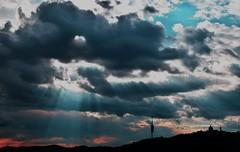 Mi light, your silence, his words/ Mi luz, tu silencio, sus palabras... (PURIFM) Tags: sunset sun lightbeams light barcelona outside landscape tibidabo sky cielo nubes clouds