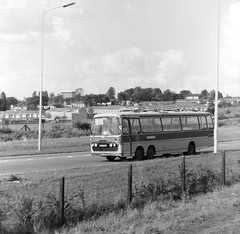 Ringway South, Basingstoke with Oakley's Coach (Cross Duck) Tags: ilfordfp4 basingstoke oldbasingstoke oldphotograph blackandwhite monochrome mediumformat ilfordfilm motorcoach bus tourbus mamiyac220 mamiyaflex