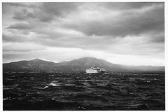 051_36 (jimbonzo079) Tags: ferry boat ship vessel sea grain fujicolor superia xtra 400 film negative analog bw convert blackwhite black white hellas evia island seascape scape art 35mm ωρωποσ αττική ελλάδα ελλασ europe light mood slr 135 greek gr weather cloud wave mountain mount vintage country oropos scan 2017 outdoor canon ae1 fd 50mm f18 lens konica minolta dimage dual iv canonae1 fd50mmf18 fujicolorsuperiaxtra400 konicaminoltadimagescandualiv