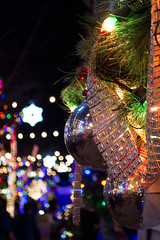 Multicolor lights and ornament (Molly Des Jardin) Tags: philadelphia southphilly philly christmas lights festive holiday decorations ornament ball reflections garland bokeh macro miracle 13thstreet multicolor pa usa