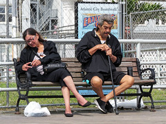 They Have Stories To Tell (Multielvi) Tags: atlantic city new jersey nj bpardwalk shore man woman smoking cigarette couple candid