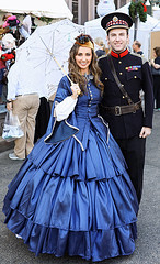 Handsome Couple (wyojones) Tags: texas galveston dickensonthestrand holidayfestival hat dress brunette hair girl lady lovely woman beautiful beauty feathers smile pretty curls boy man gentleman dressuniform handsome parasol hoopskirt